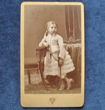 Carte-de-visite antique depicting a young girl by TheLadyatSkiers