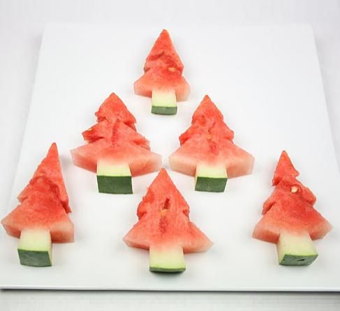 Watermelon Christmas Trees! Adorable.  And what an utter shame is I happen to get watermelon juice everywhere and have to go for a swim.
