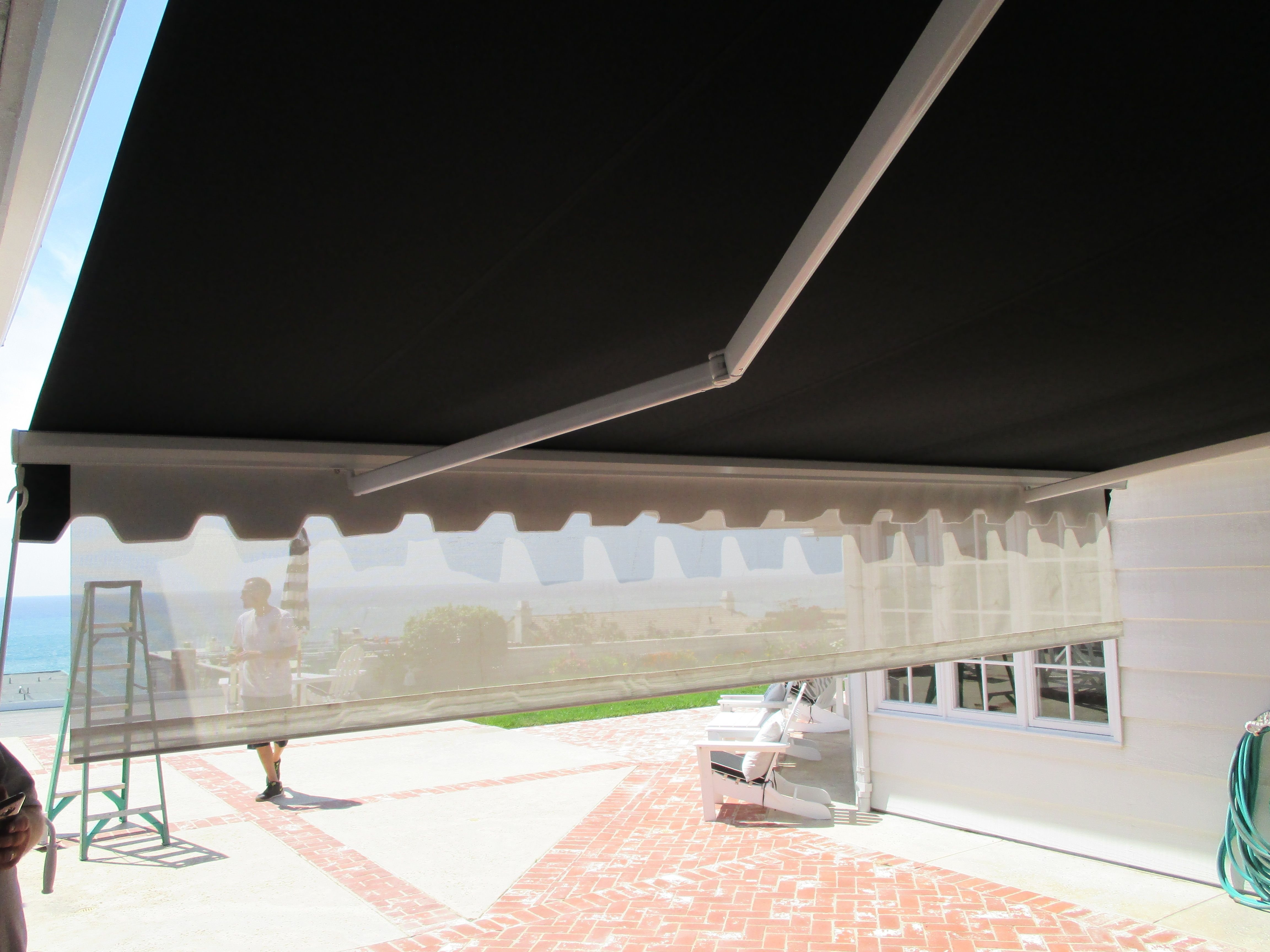 Check Out This Unique Motorized Retractable Awning With Decorative Trim And A Manual Drop S Retractable Awning Wood Trellis Home Improvement Projects
