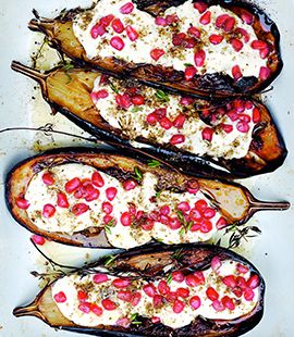 Eggplant with Buttermilk Sauce - Perhaps the most recognized recipe from Ottolenghi's best-selling cookbook Plenty. The eggplant's mild earthiness gets a boost of flavor thanks to the tangy, light buttermilk sauce, as well as a sprinkling of za'atar and pomegranates. Ottolenghi says any variety of eggplant will work, as long as it's fully cooked and well soaked in oil. #roshhashanarecipes