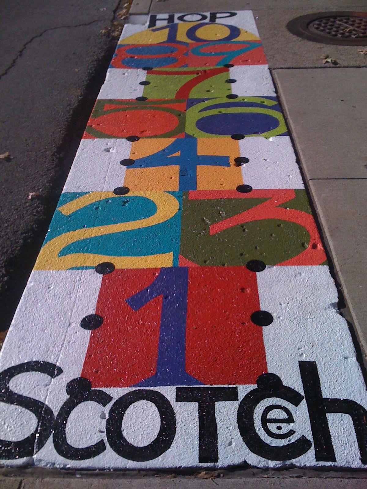 made you look storm drain public art project Hopscotch