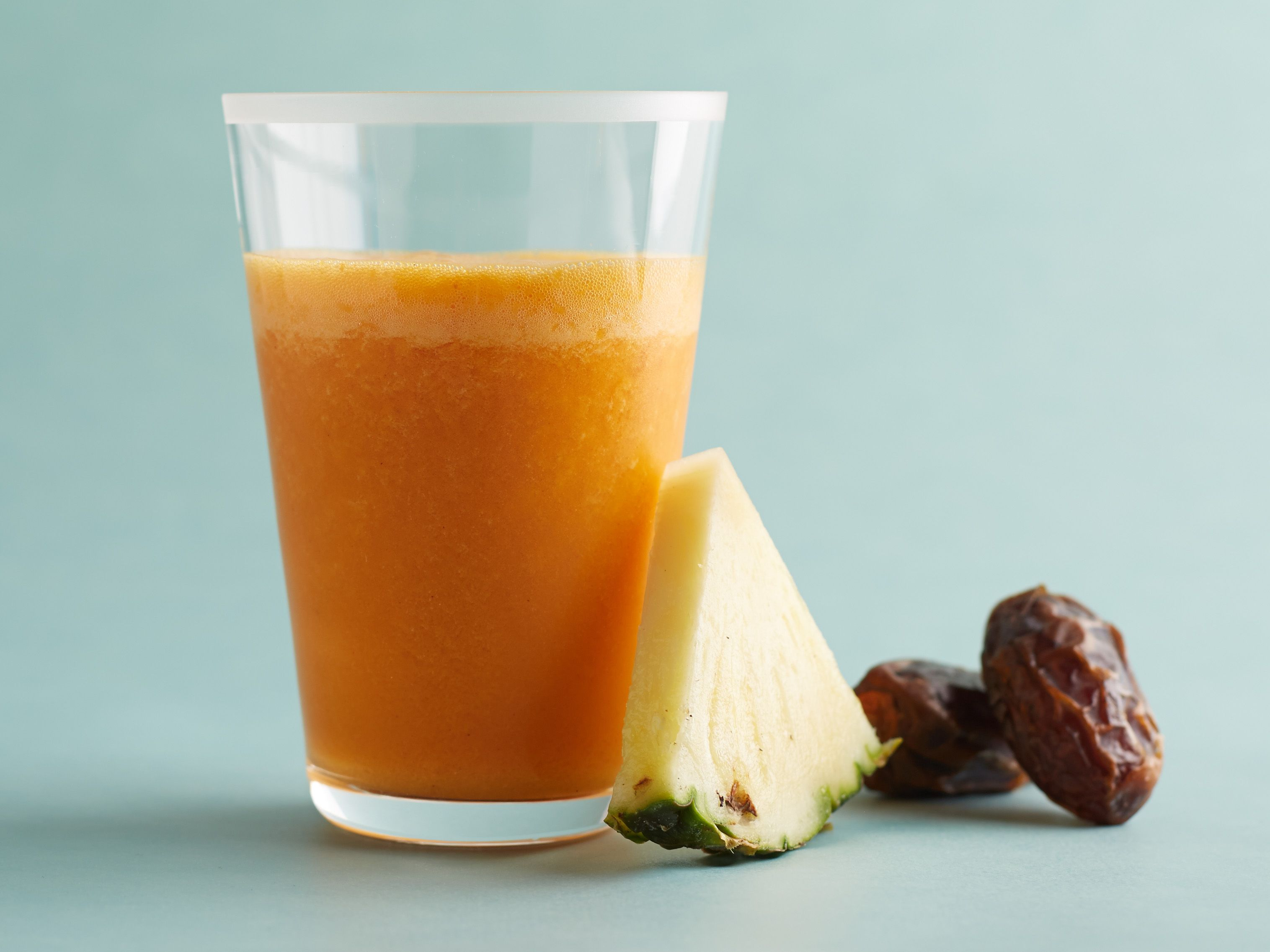 Carrot-Pineapple Smoothie: The combination of beta-carotene packed carrots and vitamin-rich pineapple is a delicious and healthy one in this refreshing smoothie. Freezing carrot juice cuts out adding regular ice cubes, and we love using dried dates as a natural sweetener.