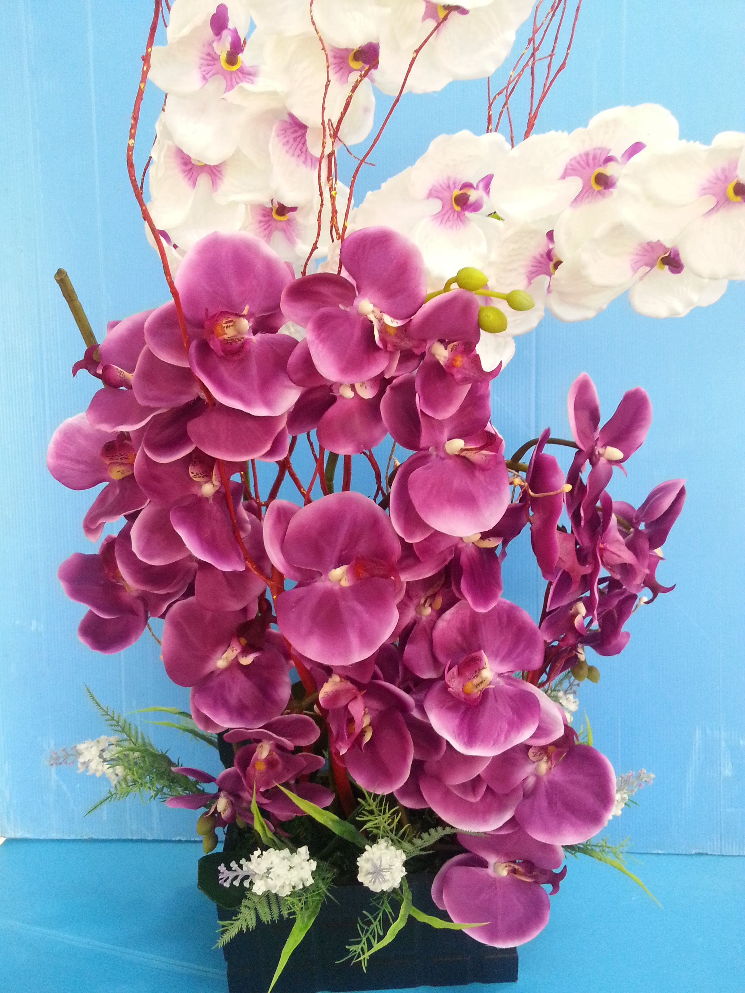 Artificial flower arrangement of orchids ochiatflorist