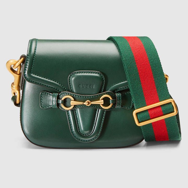 d41df497 Get a little green in your life with this Gucci lady web leather shoulder  bag on ShopStyle!