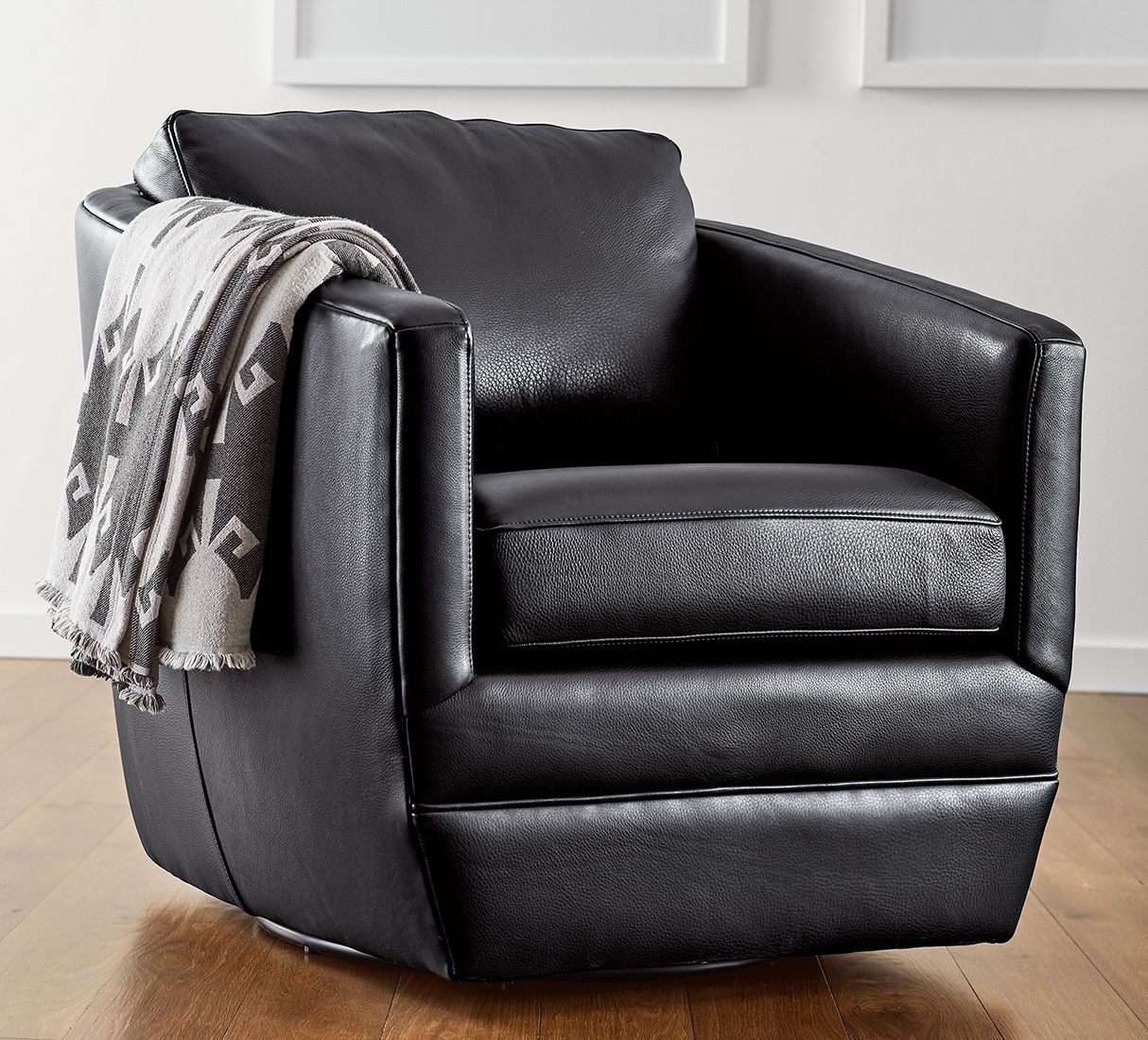 A modern leather swivel chair that looks right at home in