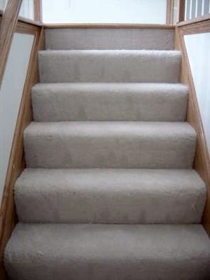 Carpeted Stairs With Wood Trim