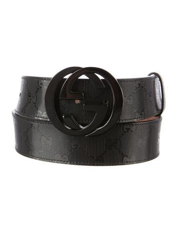 Black Gucci GG stamped PVC belt with gunmetal-tone hardware, logo buckle and push stud fastener.