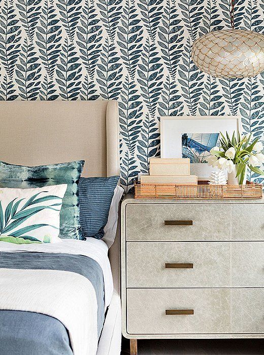 A subdued and modern coastal-inspired blue and white bedroom.