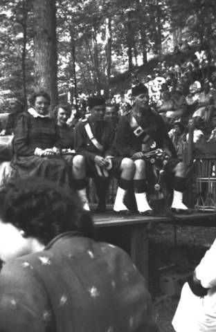 Performers in dresses and kilts seated on stage at the American Folk Song Festival, circa 1952. :: Jean Thomas, The Traipsin' Woman, Collection