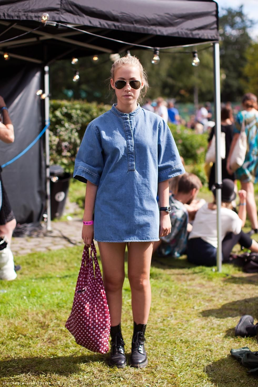 f84b343969b How to Style a Denim Dress For Spring 2015 - festival outfit  boxy denim  mini dress styled with aviator sunglasses + lace up boots