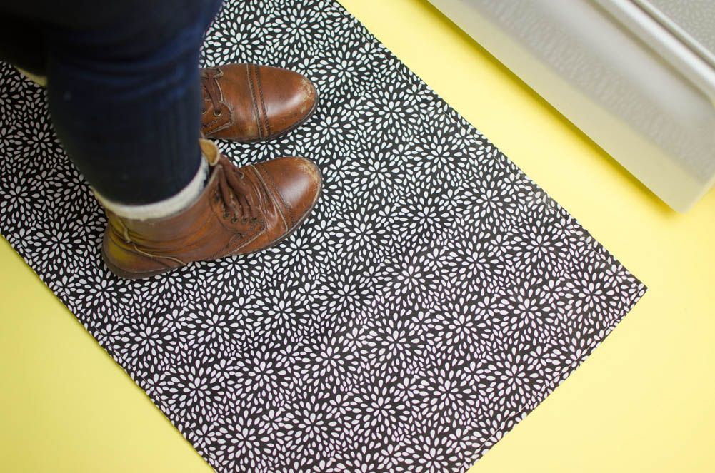 Even if you don'tsew, but you'reout in town and spot some beautiful fabric at the craft store and you're wracking your brain to think of what you could use it for, this is the project for you! With thisDIY Rug, you can take your favorite fabric and turn it into a cute functional rug perfect for your space.