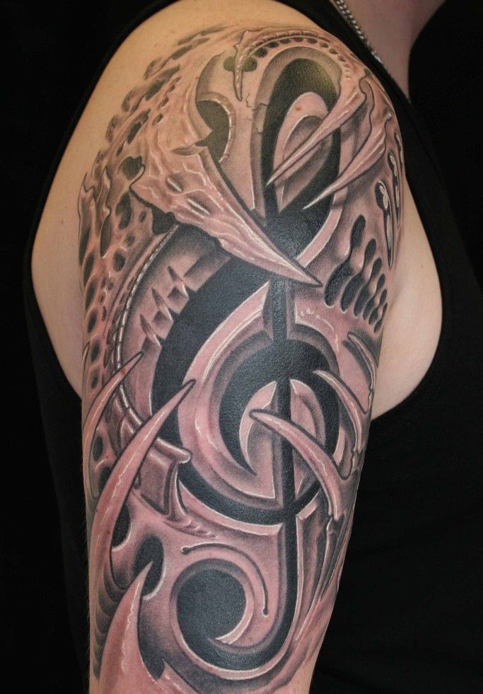 25 Amazing Biomechanical Tattoos Design Biomechanical Tattoo Design Music Tattoo Sleeves Sleeve Tattoos