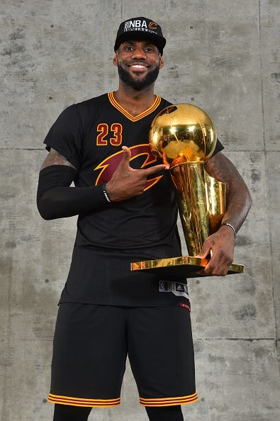 d1b054e3759 LeBron James of the Cleveland Cavaliers poses for a portrait with the World  Championship Trophy after winning the NBA Championship against the Golden.