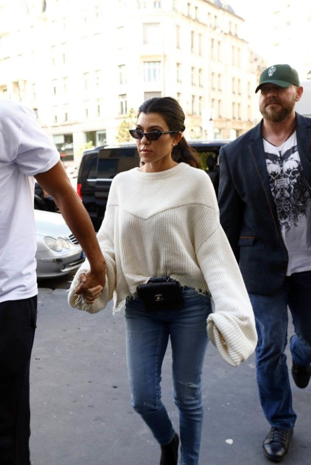 357275a949ca Kourtney Kardashian wearing Chanel Vintage Quilted Bag Chain Belt Fanny  Pack, Balenciaga Knife leather ankle boots, Ray-Ban Bausch