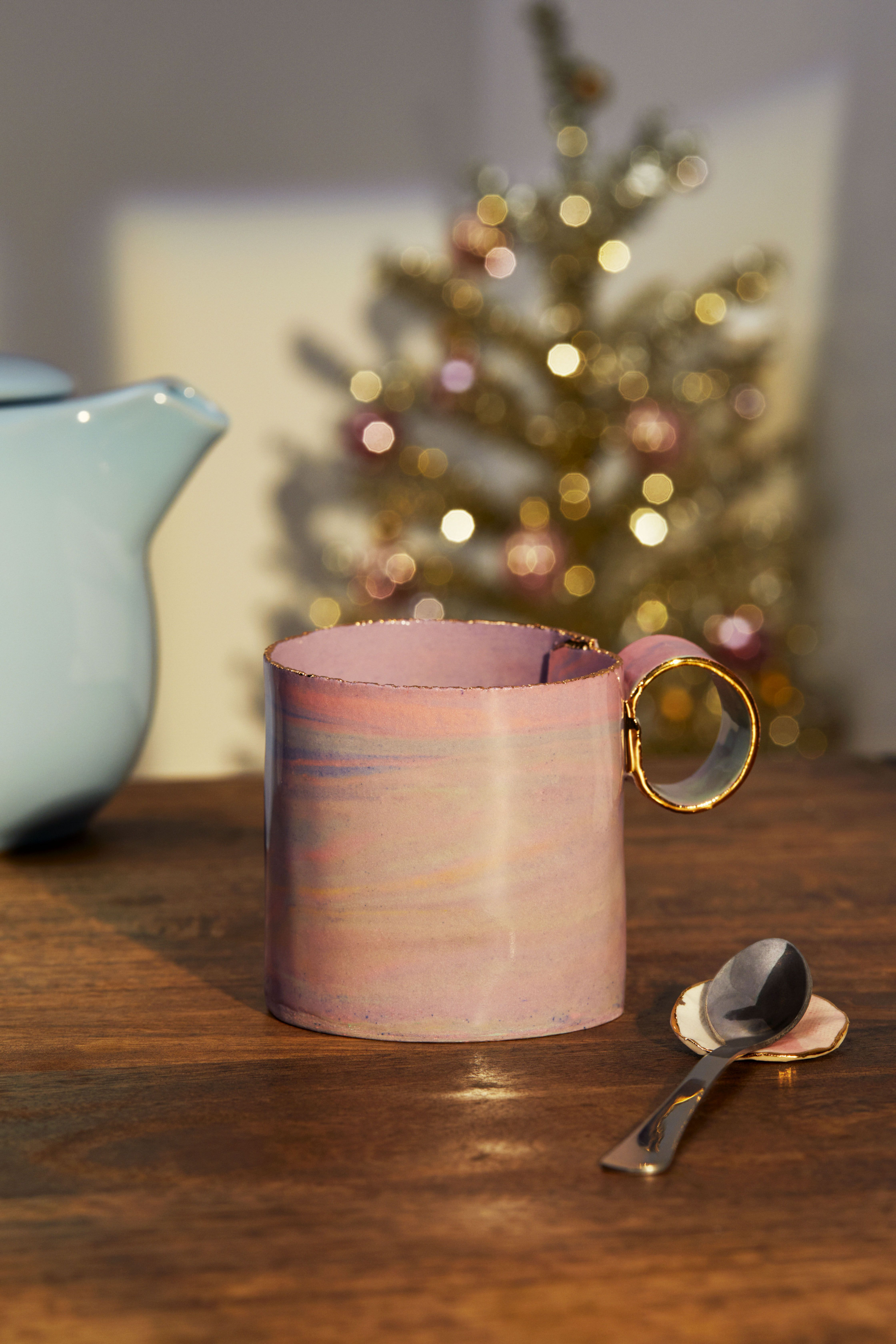 Cute hand-built irregular porcelain mug. It has a delicate gold luster detail and a color combination of colored clays. Give to the coffee lover for their morning cup or use to hold pens at your WFH set-up. Find affordable gifts with tons of personality this holiday season only on Etsy.
