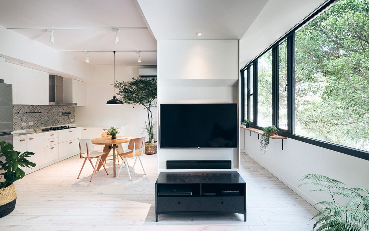 Bright Apartment With Clean White Decor Wood Accents Green Plants Bright Apartment White Decor Budget Friendly Kitchen Remodel