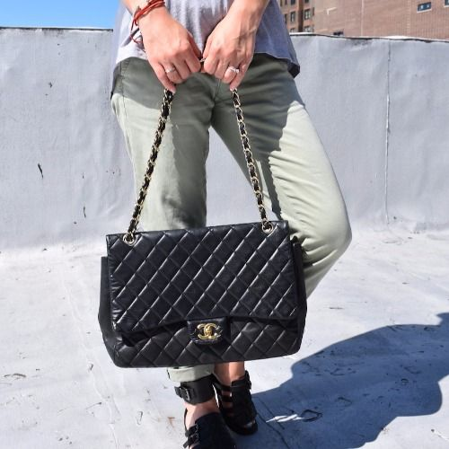 b2bbc822fba3 Rent this black Chanel quilted maxi flap bag on DesignerShare.com ...