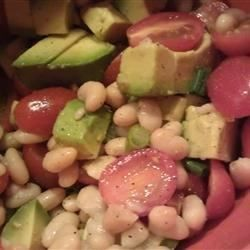 Cannellini beans, avocado, and grape tomatoes are tossed with lemon juice and olive oil in this simple and tasty salad.