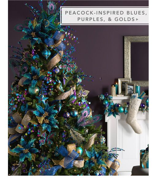 Peacock inspired blues, purples and golds for the Christmas tree is