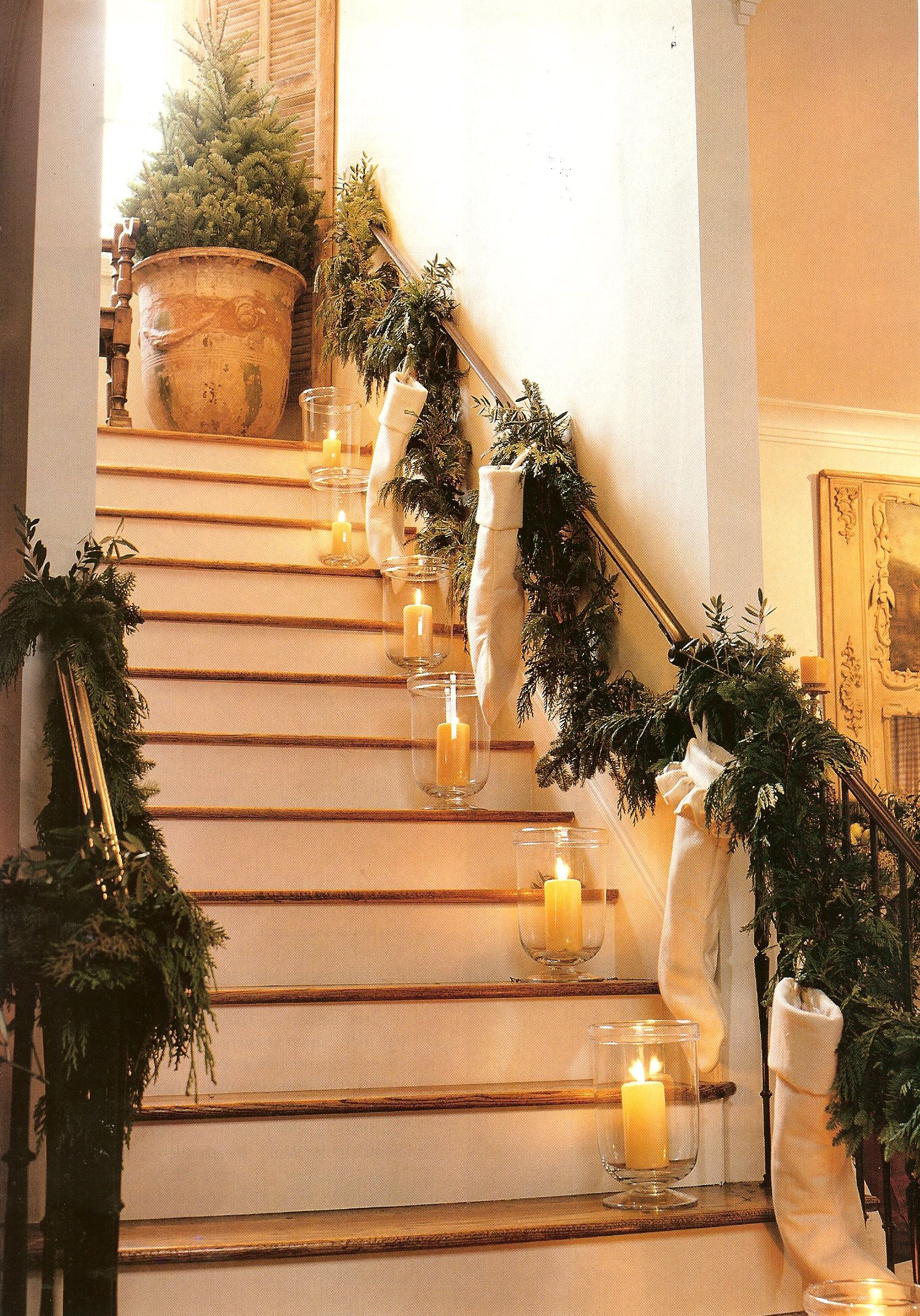 Candles on the steps and the stockings hung on the stair - Christmas decorations for stair rail ...
