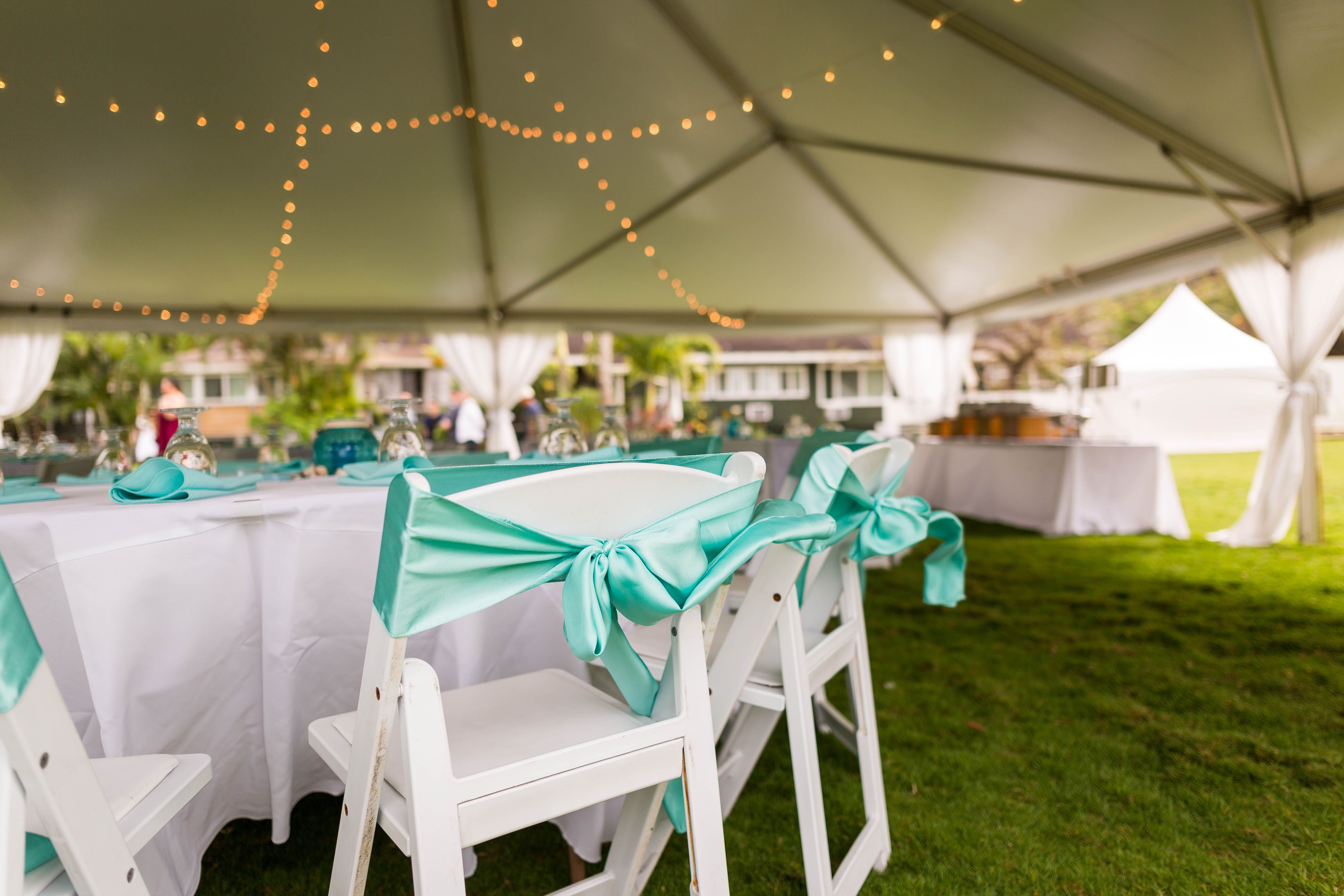 Tented Outdoor Wedding Venue On The North S Of Oahu At Loulu Palm Estate Adorable Reception With Turquoise Blue Bows White Folding Chairs