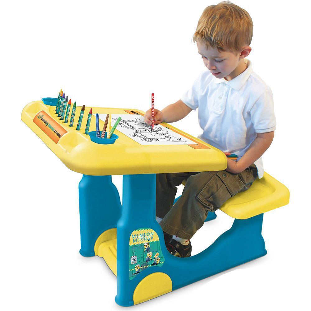 The Minions Sit & Play Creative Art Desk features:<br><ul><li ...