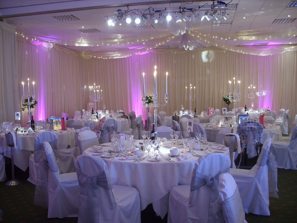Wedding hall decorations with drapes for Hall decoration images