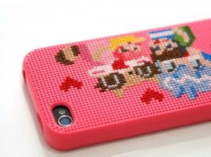 hmmm...cross stitching and the iphone...who knew the two would ever meet
