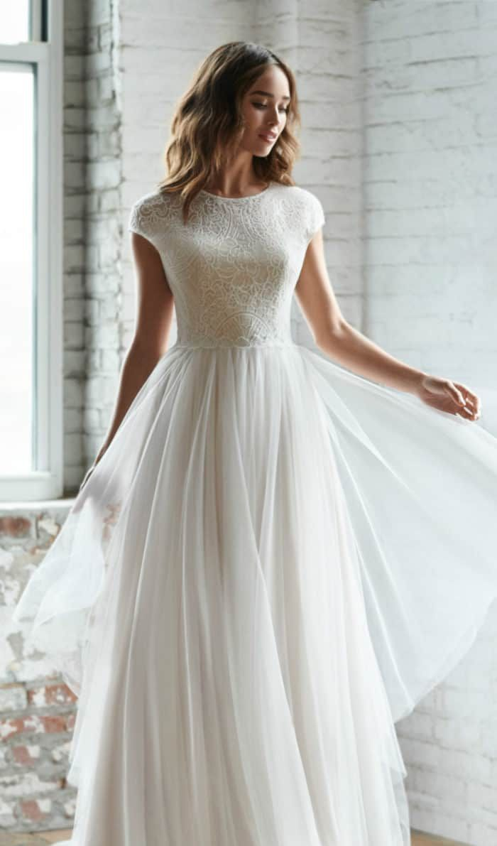 Gorgeous lace cap sleeve and tulle wedding dress under $2000 | Riva by Ti Adora Fall 2018 #weddings #weddingdress #bridal #bridalgowns #capsleeveweddingdress