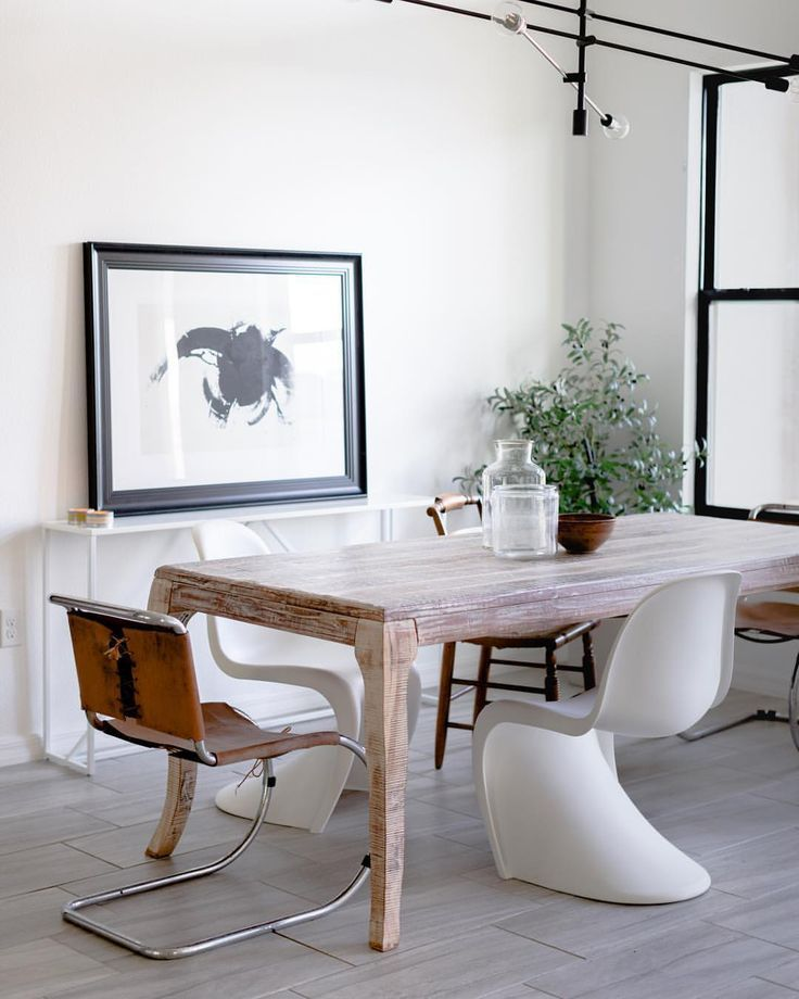 Modern dining room with white panton chairs and antique