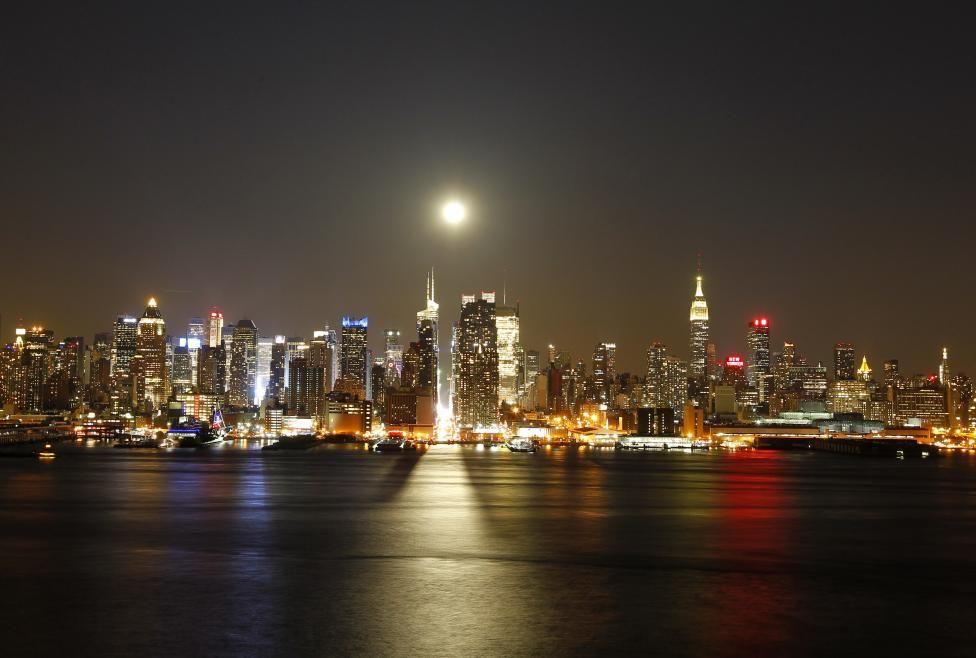 Framing Manhattan   Full moon rising, 42nd street and Moon rise