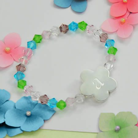 Our Little Girl's Flower Charm Bracelet is the perfect piece of jewelry for a lovely little princess! This enchanting child's bracelet is outfitted with sterling silver-plated hardware and multi-colored Swarovski crystals in a dazzling pattern, which is sure to please any child. Because it's designed with an elastic wrist band, it's sure to please (and fit) any child... making this sparkly keepsake a must have for playing dress up! Includes a free organza gift pouch.