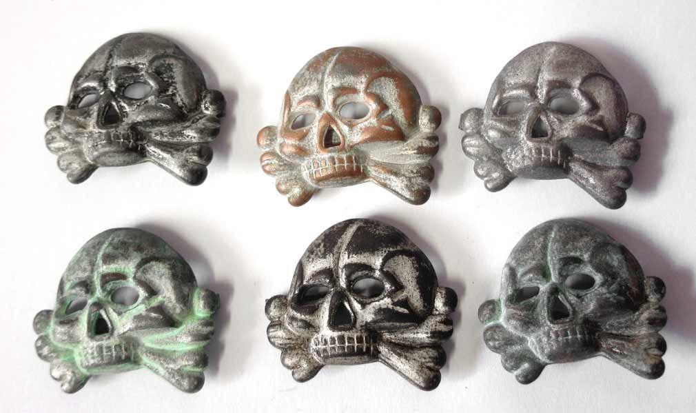 Waffen & Allgemeine SS Jawless Skull Badge  Here is our aged