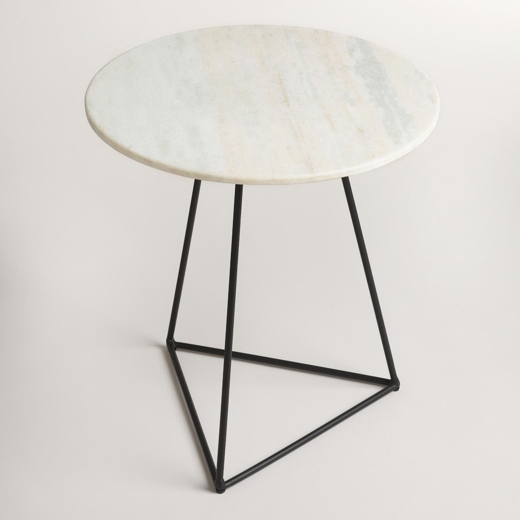 A Small Table With Round White Marble Top And Black Steel Base