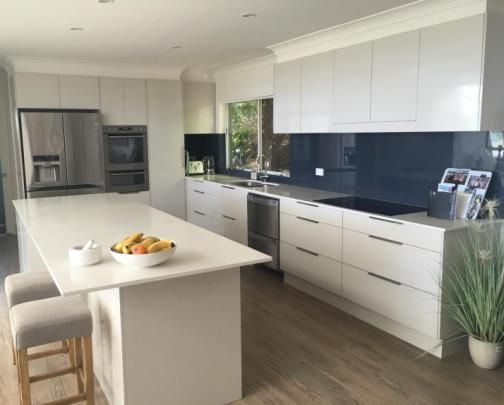 Classic Gold Coast kitchen, with 20mm stone tops. Melamine gloss ...