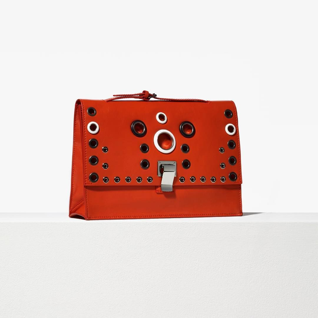 « The lunch bag in red leather with multicolored eyelets. Explore Pre-Spring 2016 Accessories in stores now. #proenzaschouler »