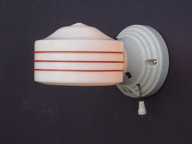 bathroom light fixture with outlet plug. when it comes to interior