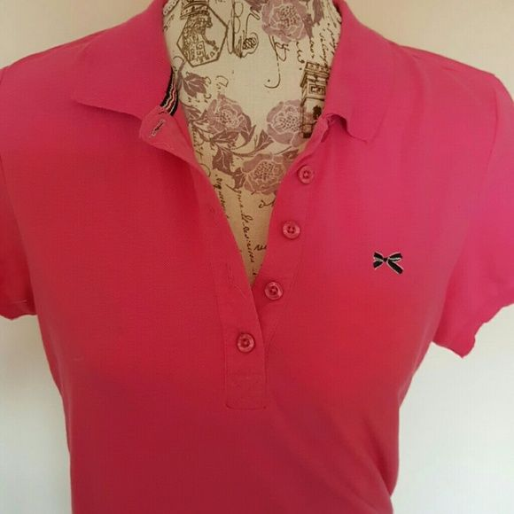 Tommy Girl Pink polo Cute with an embroidered bow. Size is XL but fits like M-L Tommy Hilfiger Tops Button Down Shirts