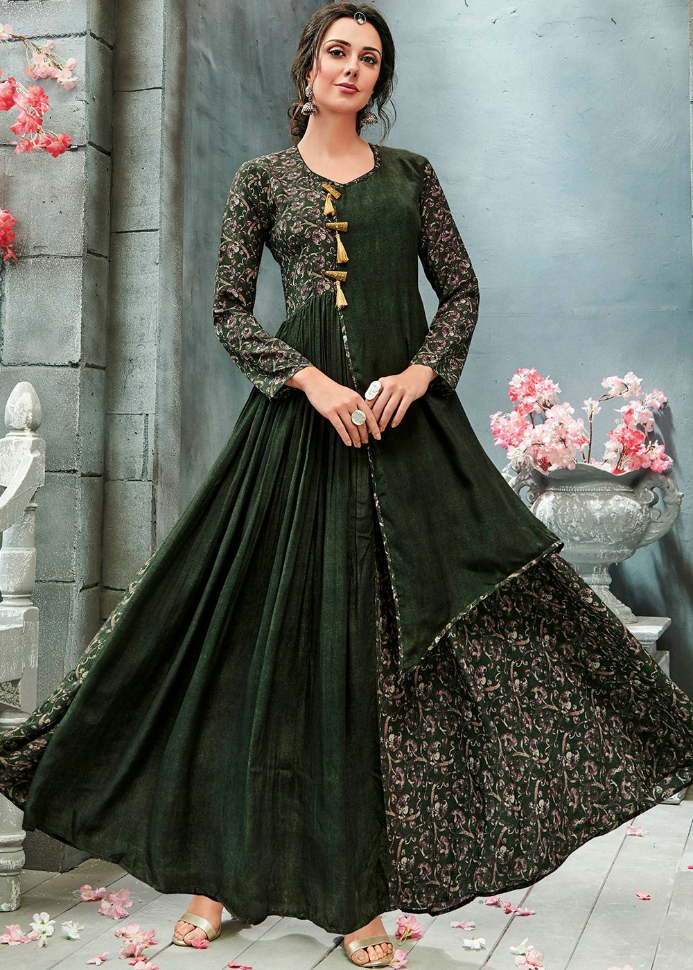 52f75ce4e1 Showcasing a dark green readymade floor length twin layered maxi dress in  georgette designed with stunning