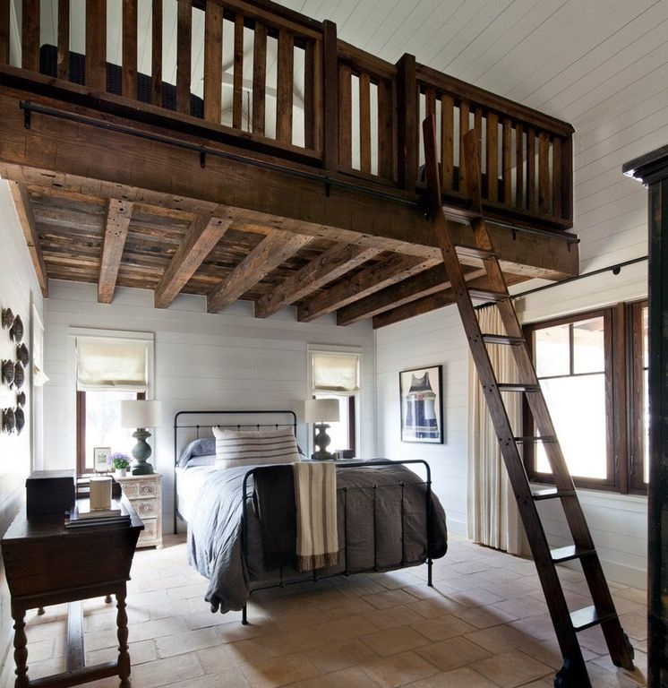 Dominating, dark wood bedroom loft boldly contrasts clean