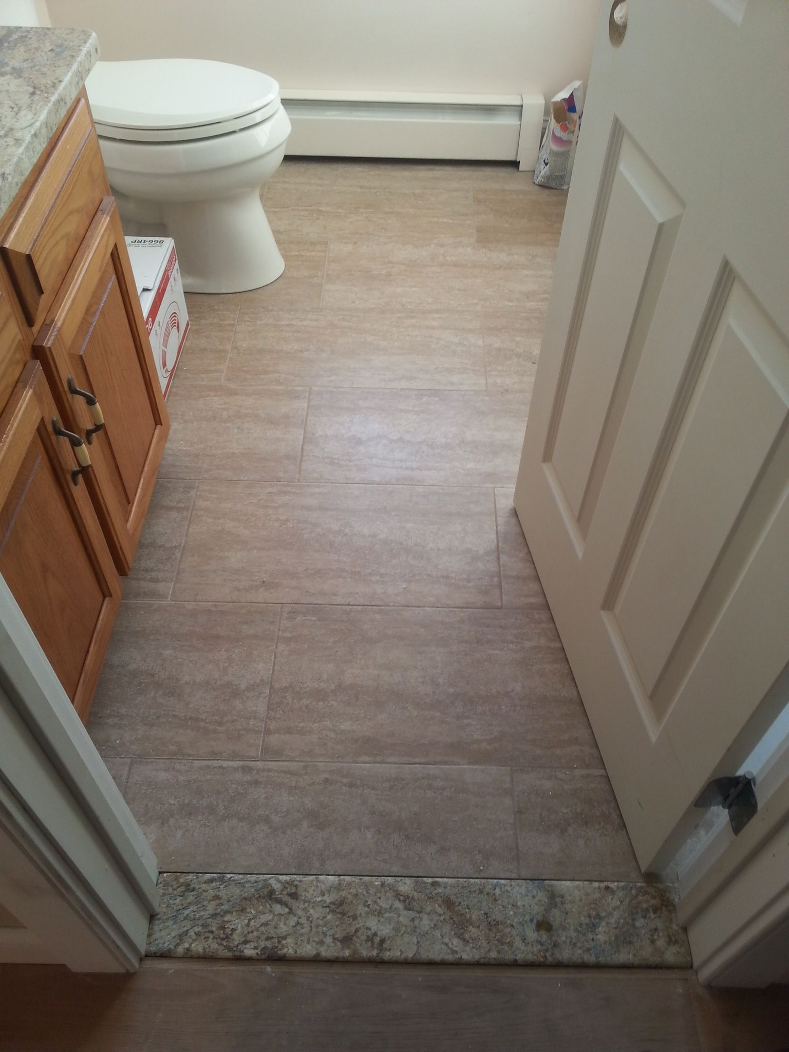 12x24 Tile Installed With Custom Granite Threshold In