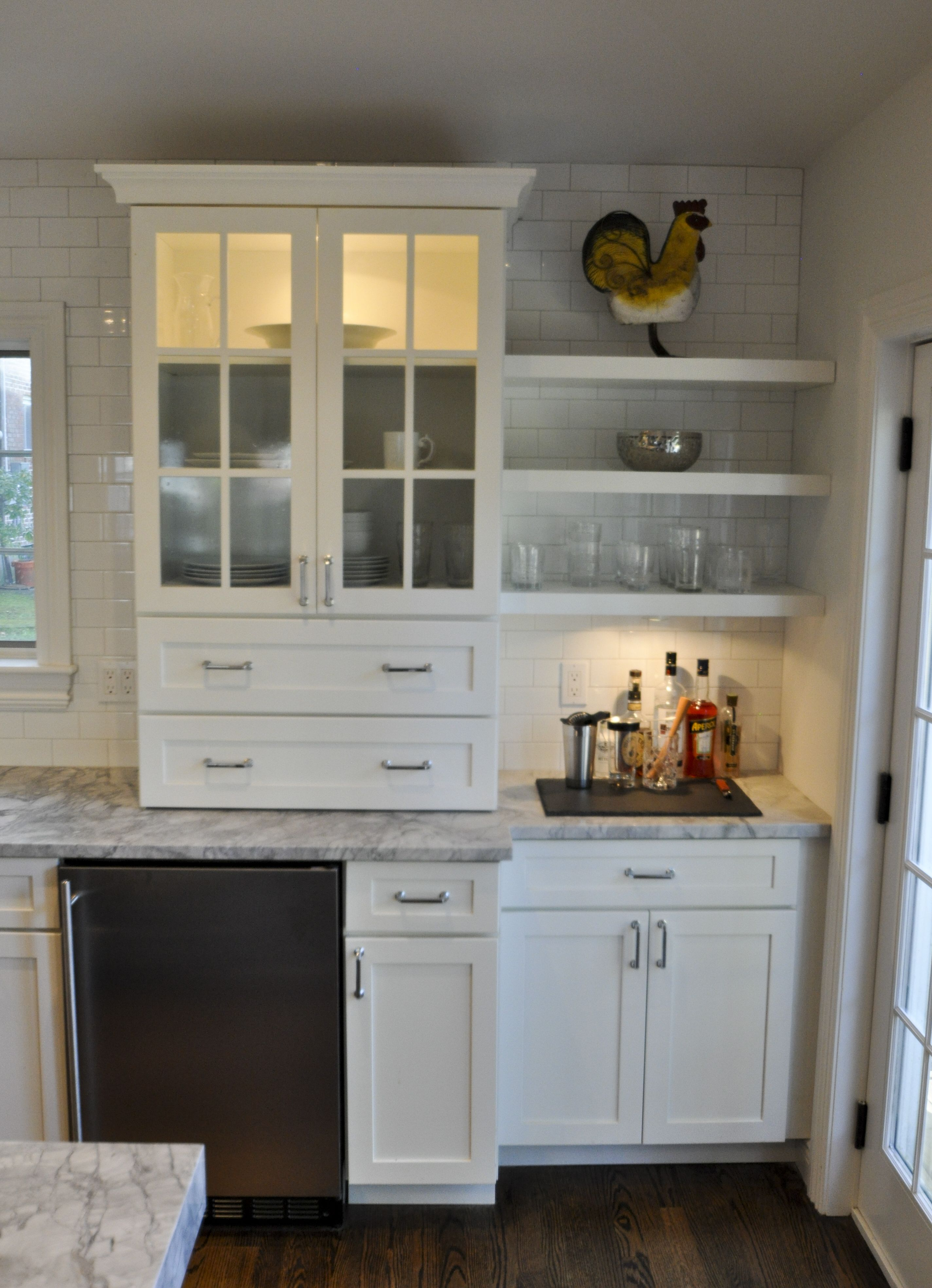 Cabinet Tower With In Cabinet Lighting And Flanking Floating Shelves Kitchen Remodel Kitchen Construction Luxury Kitchen Design