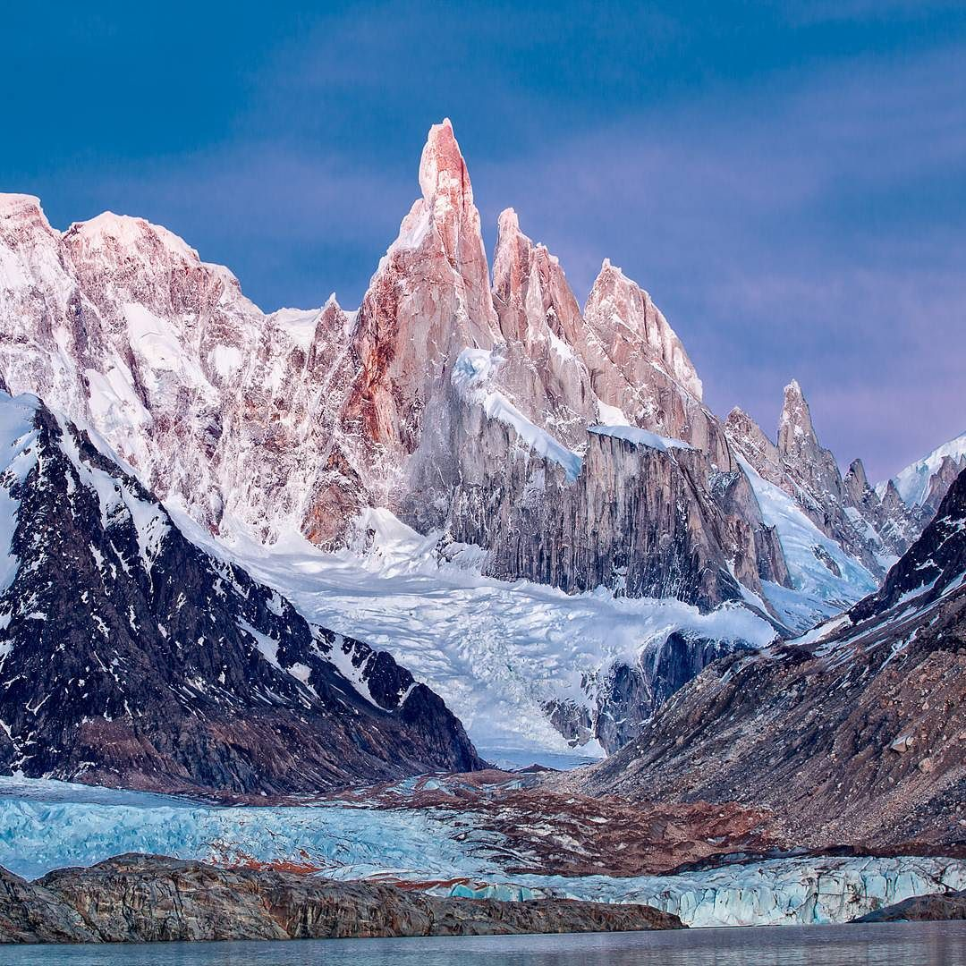 Early morning dawn light hitting the peak of one of my favorite mountains in South America Cerro Torre in Los Glaciares National Park Argentina. What is your favorite mountain in the world? by colbybrownphotography