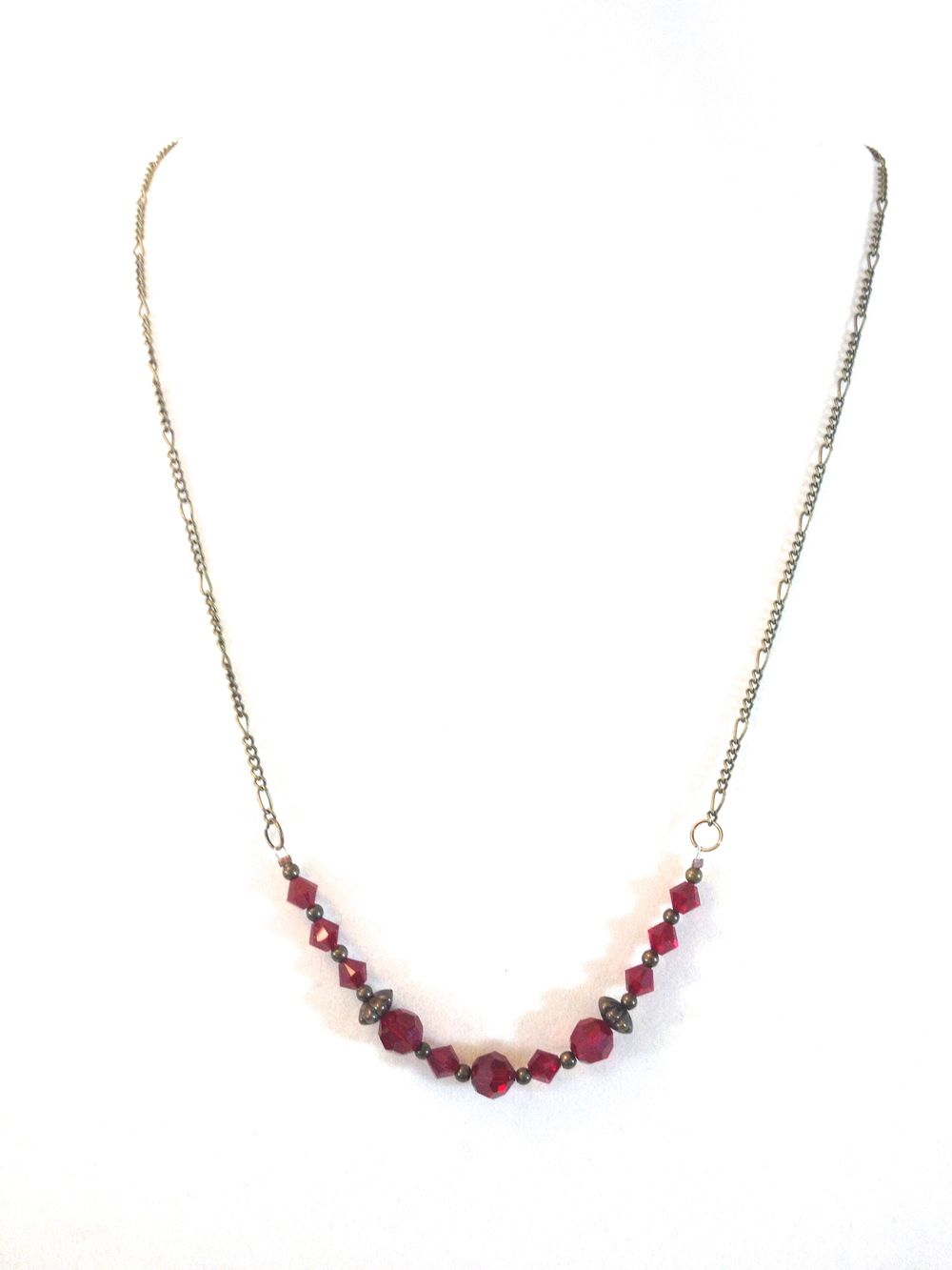 """Garnet and Gold  $18.00 25"""" of antique gold-tone figaro chain and accents and deep garnet red Swarovski crystals.  Dramatic.  #handmade #jewelry #bracelet #necklace #earrings #swarovski"""