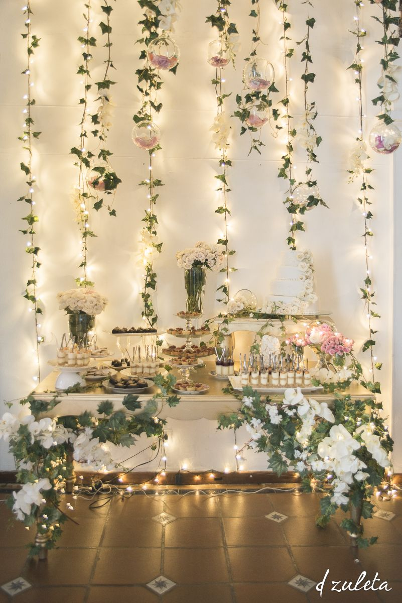 Hanging lights wedding decor  Mesa de Postres Boda  Wedding Dessert Table  Photography by Diana