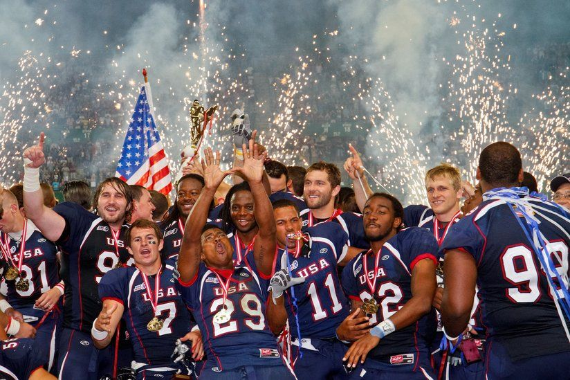 Members of USA Football team celebrate a championship win