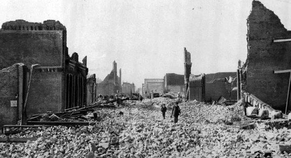 The Great San Francisco Earthquake, 1906. People walk through the rubble.