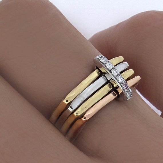Handcrafted in 18k white, rose and yellow gold, 4 square rings hammered and linked