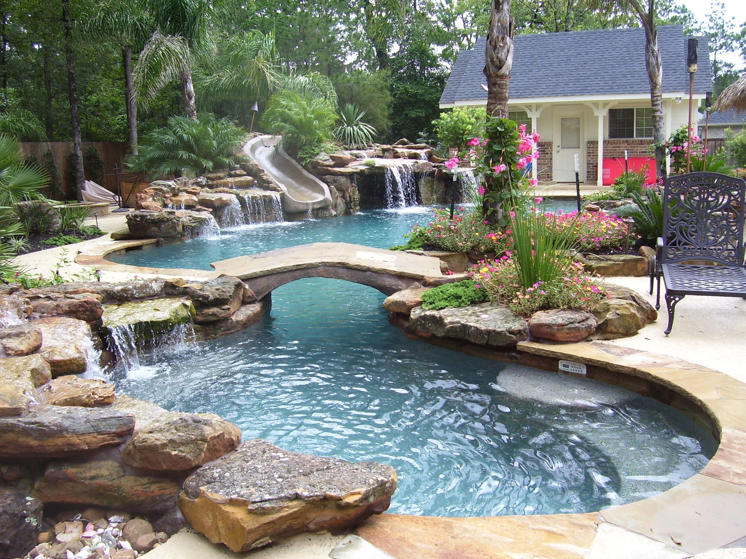 Natural mossrock waterfall pool with slide, beach entry