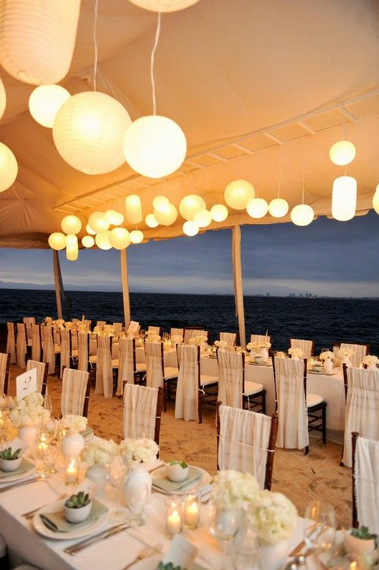 We love this lovely outdoors beach wedding reception! Warm weather on the west coast permits a reception like this! The lights, the beach, the white table settings and flowers... #perfection! Find venues like this one for your next event at www.eventup.com #EVENTup